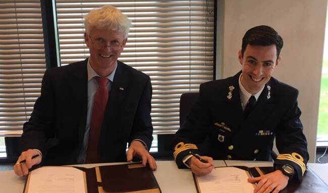 Jelle Loosman, Managing Director of Damen Shipyards Den Helder and Commander Marc Hermsen, Head of Purchase Office at DMO, during the contract signing ceremony. Damen Photo.
